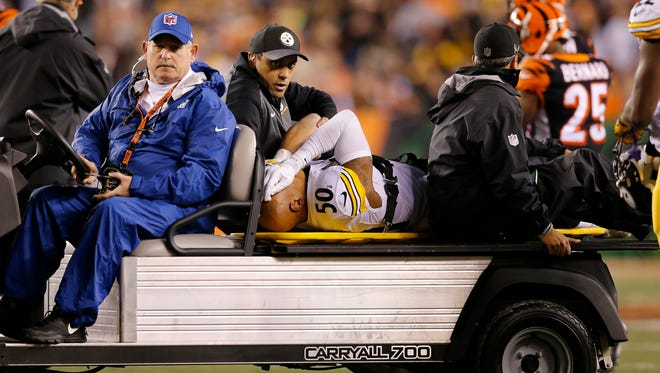 Pittsburgh Steelers inside linebacker Ryan Shazier (50) is carted off the field with a back and head injury after colliding with Cincinnati Bengals running back Giovani Bernard (25) on a carry in the first quarter of the NFL Week 13 game between the Cincinnati Bengals and the Pittsburgh Steelers at Paul Brown Stadium in downtown Cincinnati on Monday, Dec. 4, 2017.