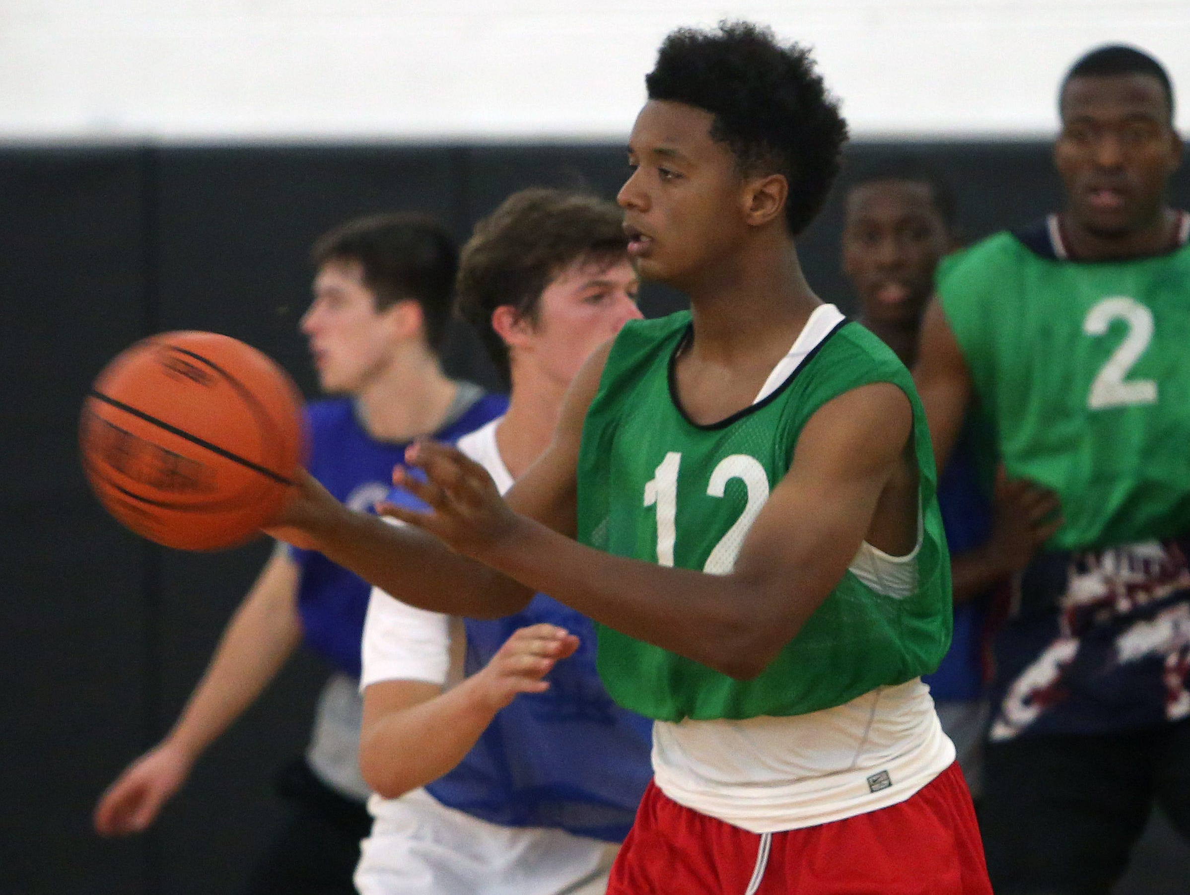 Kennedy Catholic's Elijah Hughes passes to a teammate during practice with the Hudson Valley team at Croton High School July 29, 2015. The team is preparing for the BCANY Summer Hoops Festival.