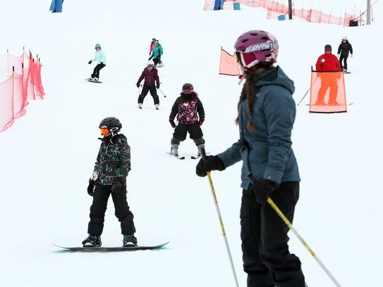 Skiiers at Thunder Ridge Ski Area.