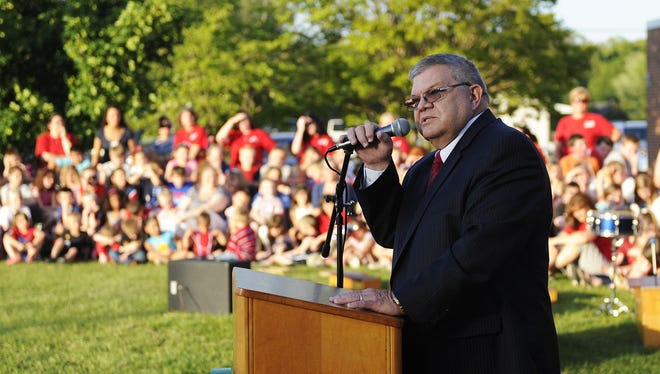 Former principal George Earhart ('85-'87) speaks during the closing ceremony for Ladd Elementary School on  May 15, 2013, in Waynesboro.