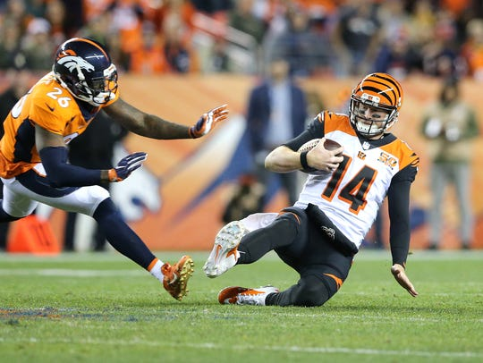 Cincinnati Bengals quarterback Andy Dalton slides for