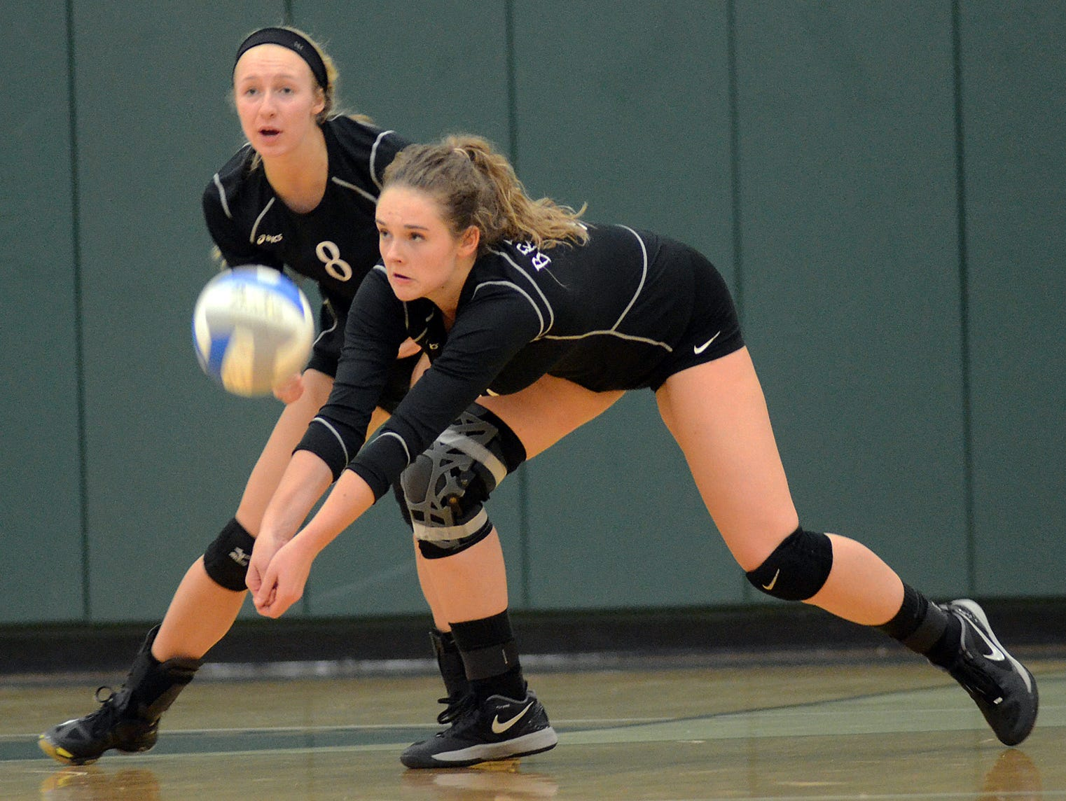 Brighton's Ellen Kirchmeier, right, and Olivia Kistulenetz, left, did all they can, but the Bulldogs fell to Hartland, 3-2, in Wednesday night's district semis.