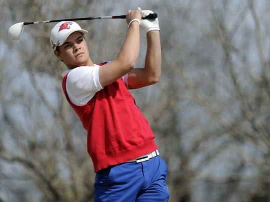 Cooper's Cory Churchman hits a shot from the fairway during the Big Country Invitational at the Diamondback Golf Club on March 7, 2012.