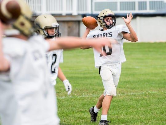 Delone Catholic quarterback Evan Brady prepares to throw during a recent team practice.