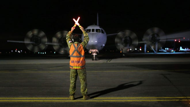 A Royal Australian Air Force AP-3C Orion aircraft taxis on the tarmac after returning from a sortie over the southern Indian Ocean in search for Malaysian Airlines Flight MH370, at RAAF Pearce Air Base in Bullsbrook on Sunday.