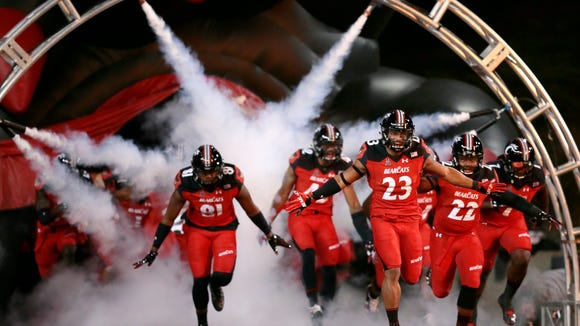 The Bearcats take the field on Senior Night before the first quarter of the American Athletic Conference college football game between the Cincinnati Bearcats and the Memphis Tigers at UC's Nippert Stadium in Cincinnati on Friday, Nov. 18, 2016.