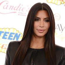 Kim Kardashian arrives at the Teen Choice Awards at the Shrine Auditorium on Sunday, Aug. 10, 2014, in Los Angeles. (Photo by Jordan Strauss/Invision/AP) ORG XMIT: CARR127