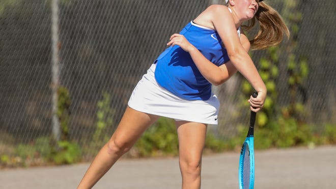 Ravenna sophomore Hannah Chrin hits the ball in her 6-4, 6-4 second singles victory over Field Monday afternoon.