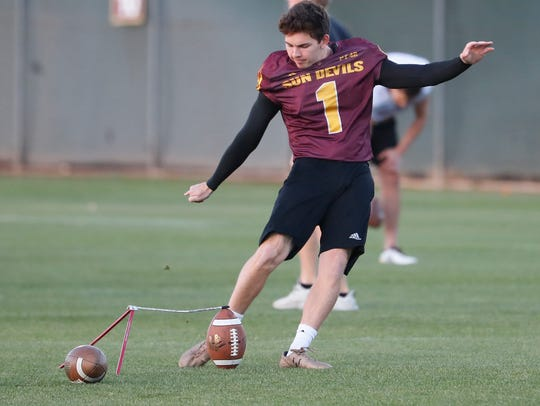 ASU's Brandon Ruiz (1) kicks field goals during a spring