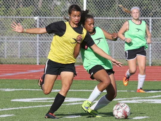 Elmira's Kendra Oldroyd, left, was a STAC West all-division selection last season at forward.