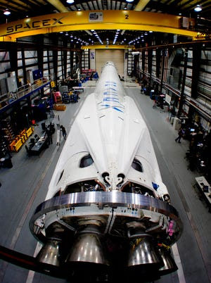 SpaceX scrubbed the launch of a Falcon 9 rocket to the International Space Station on Monday, April, 14, 2014, because of a helium leak. The Falcon 9 pictured here is in a hangar at Cape Canaveral Air Force Station.