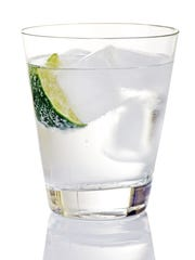 A gin and tonic is a refreshing summertime beverage.