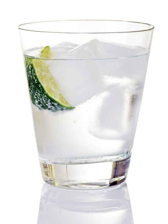 Gin And Tonic On Ice With Lime Wedge