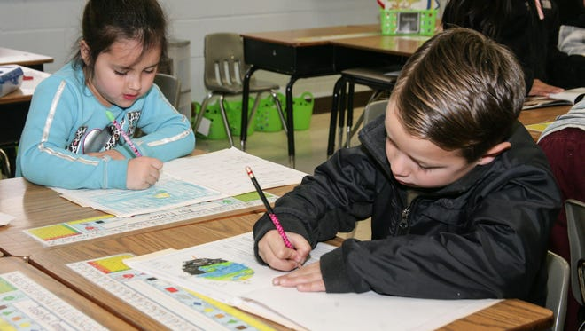 Students work on pilot curriculum at Krisle Elementary School.
