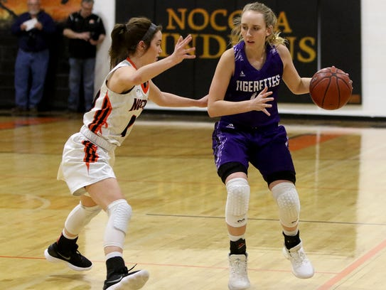 Nocona's Emma Meekins guards Jacksboro's Brinkley Richardson earlier this season. The Lady Indians and Tigerettes each have to get through Peaster to advance to the Region I-3A Tournament.