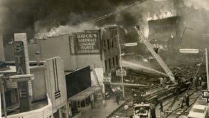 Looking west/southwest from on top of the bank building at North Seventh and East Main streets, this view shows the fires in 600 block of East Main. The  fires that erupted after twin explosions on April 6, 1968, in downtown Richmond. The Birck's Hardware store building and all of the buildings west of it on the south side of the street were destroyed by the explosions and fire.