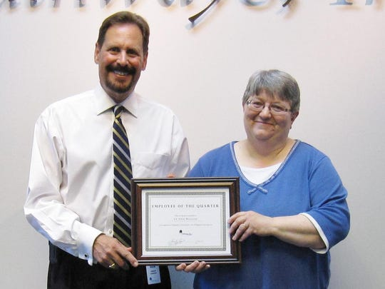 Pathways' President and Chief Executive Officer Dr. Edward J. Lukomski with employee of the quarter Lu Anne Holland.