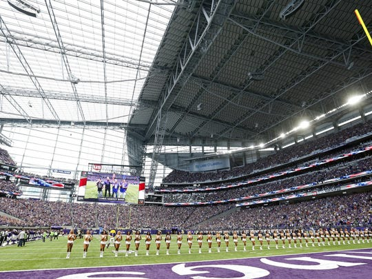 Minnesota Vikings cheerleaders line up on the field before an NFL preseason game on Aug. 28 against the San Diego Chargers in Minneapolis.
