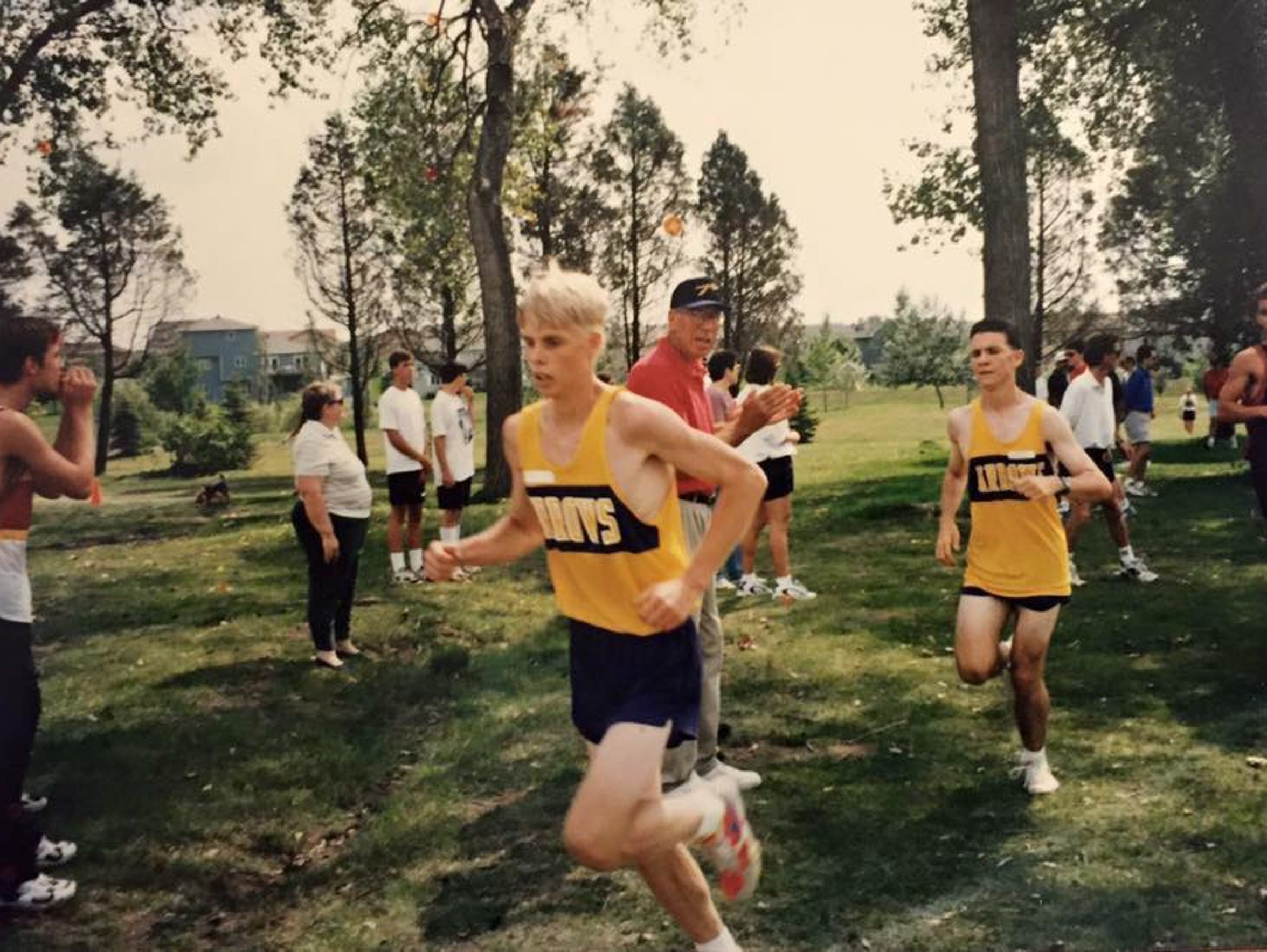 Rob Hoover, front, runs in a cross country meet for