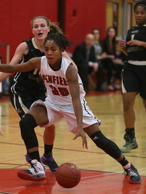 Penfield's Makaila Wilson drives through the lane to the basket against Rush-Henrietta.