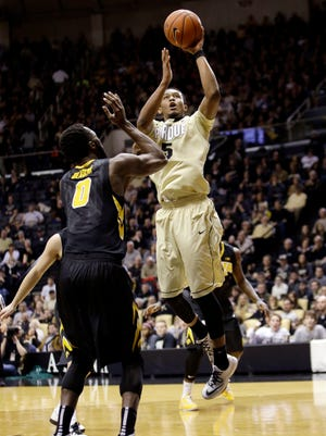 Purdue forward Basil Smotherman (5) shoots over Iowa center Gabriel Olaseni (0) in the second half of an NCAA college basketball game in West Lafayette, Ind., Saturday, Jan. 24, 2015. Purdue won 67-63. (AP Photo/AJ Mast)
