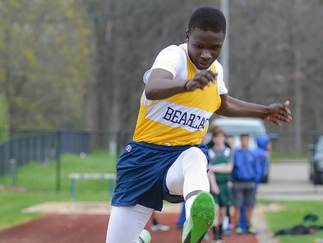 Mohamed Ahamed of Battle Creek Central participates in the long jump event at the 2016 All City Track Meet at Harper Creek High School.