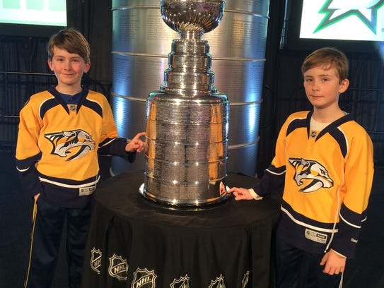 Nine-year-old twins Owen and Zachary Wood pose with