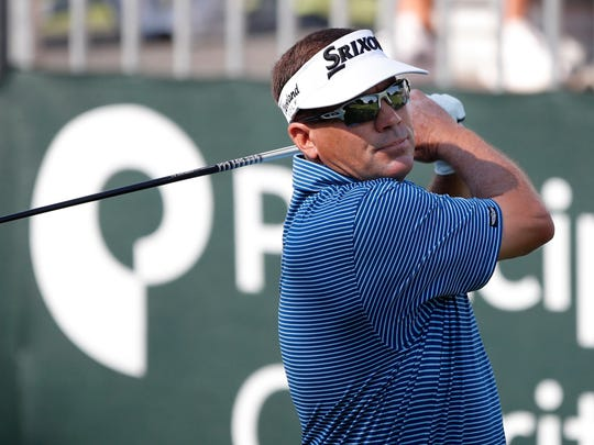 Mark Calcavecchia hits off the first tee during the