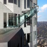 This undated artist's rendering provided by Overseas Union Enterprise Limited shows a glass slide 1,000 feet above the ground off the side of the U.S. Bank Tower in downtown Los Angeles. The 45-foot-long attraction is part of a $50 million renovation that will also put a bar and open-air observation deck on the top floors of the 72-story building.