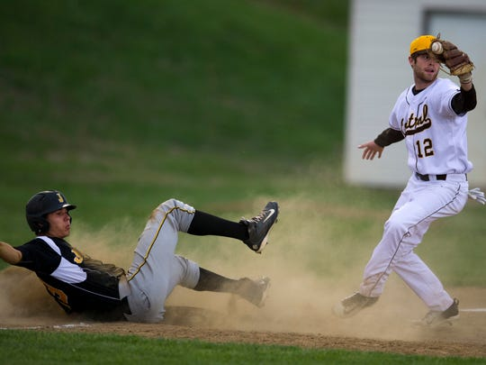 Jasper's Evan Aders is put out at third base by Central's Dalton Peerman (12) during a double-steal attempt in the top of the third inning at Central High School Monday evening.