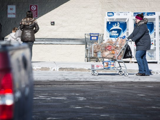 Shoppers quickly exist the Pay Less along McGalliard