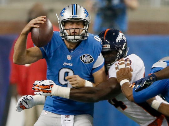 Detroit Lions quarterback Matthew Stafford is sacked by Denver Broncos DeMarcus Ware in the first quarte.