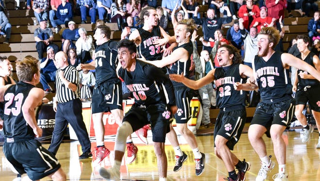 Foothill High's boys basketball team celebrates beating Pleasant Valley 62-58 in overtime to win the Northern Section Division III championship Friday at Butte College.