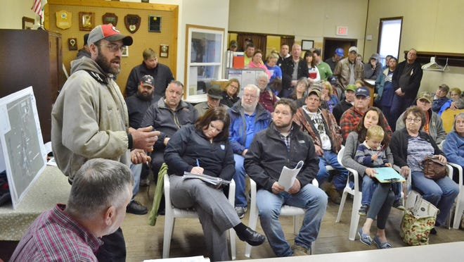 Ryan Viestenz, who farms east of the planned manure pit in the town of Little River, outlines his concerns about the project before a crowd of more than 50 people attending a hearing by the Oconto County Land Conservation Commission at the Little River Town Hall on April 10.