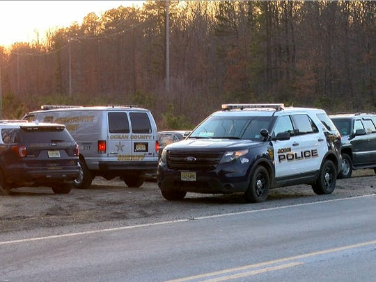 Police vehicles line South Stump Tavern Road in Jackson Township during an investigation in the Colliers Mills Wildlife Management Area last month.