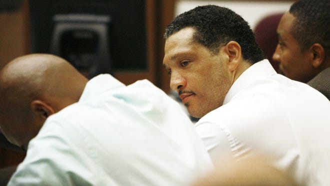Mark Goudeau looks at his attorney Corwin A. Townsend and bows his head after being found guilty of kidnapping and sexually assaulting two sisters by a Maricopa County Superior Court jury in Phoenix.