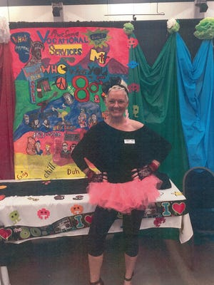 Lee Ann Denis shows her 1980s nostalgia at the 2017 Business Expo.
