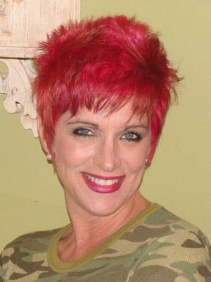 Keeping a promise to her children, Madelene Boudreaux died her hair pink before it fell out.