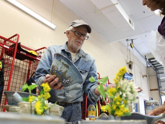 Forrest Bogan shows off a handmade pot at the Bethany