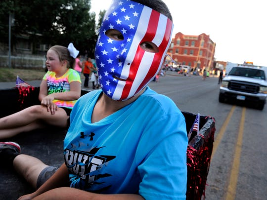 Hagen Hare, 7, rides in the back of an all-terrain vehicle with Brooklyn Barnes, 8, during the parade Wednesday August 3, 2016 for the De Leon Peach and Melon Festival and Tractor Pull. This is the 102nd year for the festival, it will conclude Saturday.