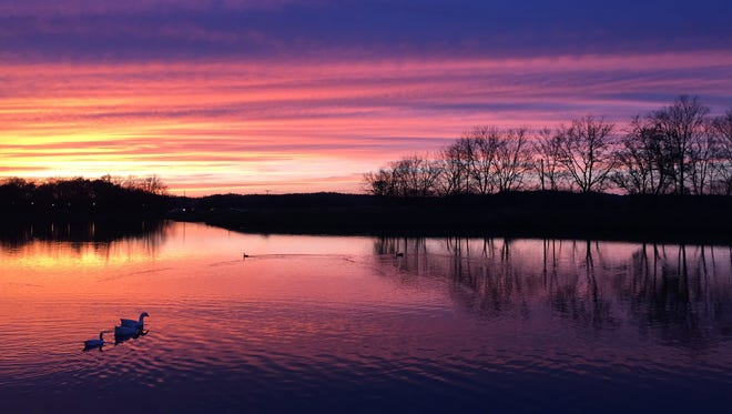 The sun sets as ducks swim in Westhaven's lake in Franklin, Tenn. in 2015.