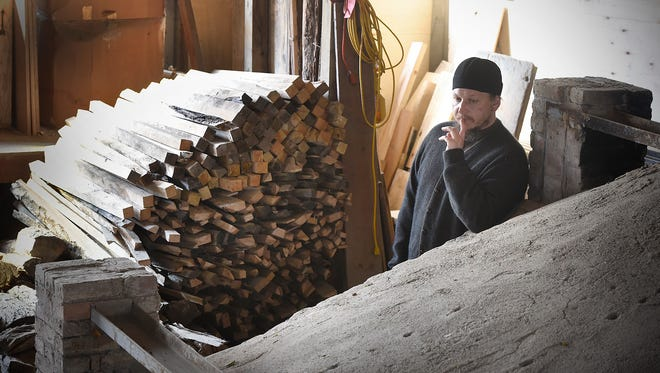 The Rev. Sergei Shatrov pauses Friday during the 13th firing of the Johanna Kiln at St. John's University in Collegeville. Shatrov traveled from Australia to be part of this year's kiln firing event.