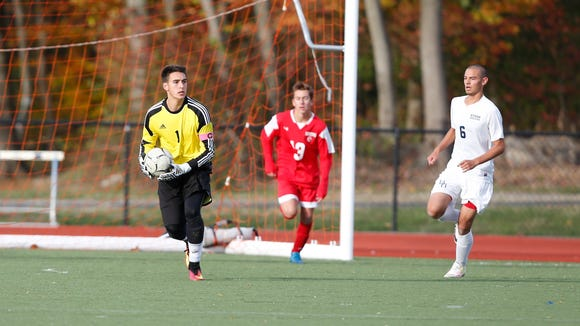 Somers' goalie Kenny Kurtz looks for a play during