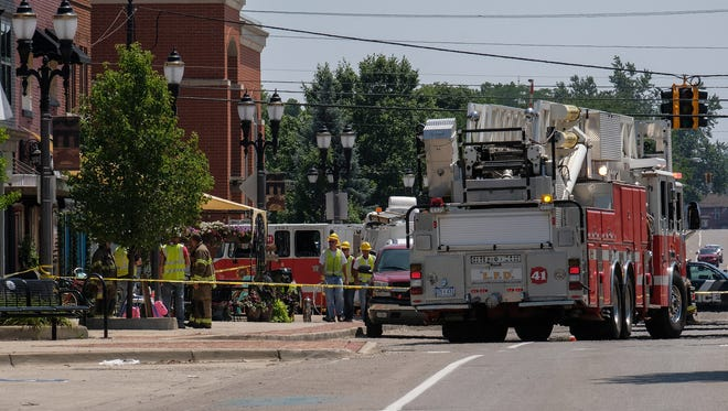 Lansing Police, firefighters and utility workers at the scene of a gas leak in Lansing's Reo Town Friday, July 13, 2018.