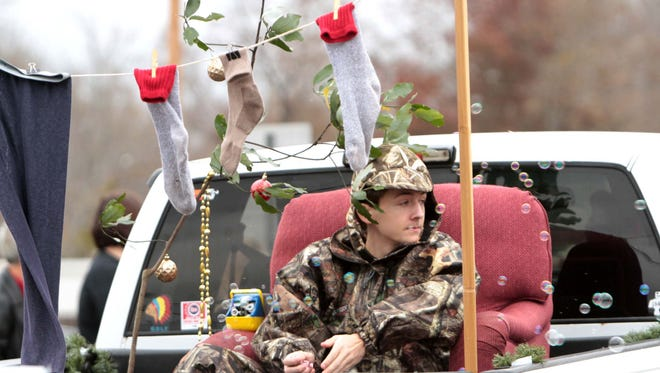Parade goers line the streets for the annual Bawcomville Redneck Christmas Parade on Saturday.