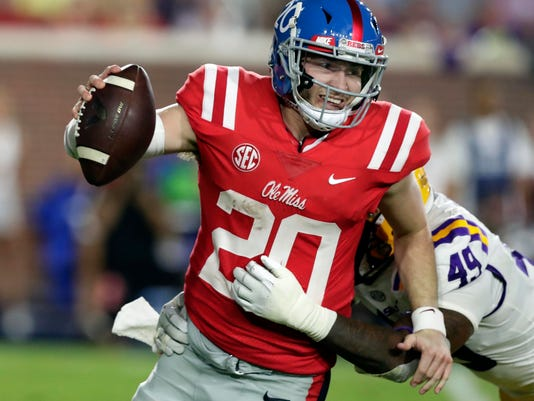 Mississippi quarterback Shea Patterson (20) is sacked by LSU linebacker Arden Key (49) in the second half of an NCAA college football game in Oxford, Miss., Saturday, Oct. 21, 2017. No. 24 LSU won 40-24. (AP Photo/Rogelio V. Solis)