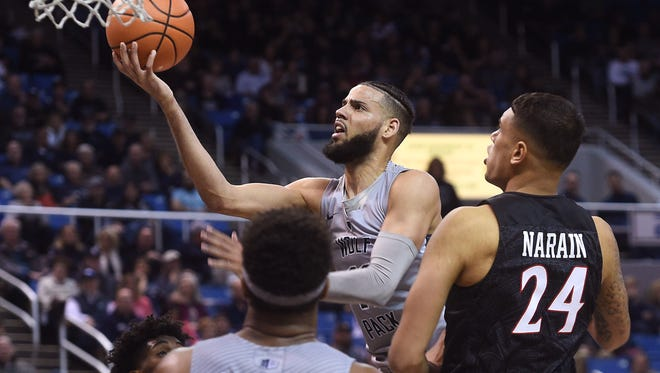 Nevada's Cody Martin drives the lane during the Wolf Pack's win over San Diego State at Lawlor Events Center last month.