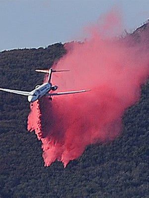 Fire retardant is dropped in the hills above Fillmore during the Thomas Fire.