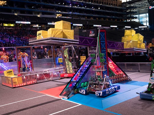 The final robotics teams and their robots do battle Saturday at Ford Field during the 2018 FIRST Robotics World Championships