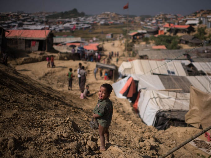A Rohingya Muslim refugee child cries as he stands